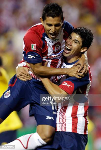 Alberto Medina and Jonny Magallon of Chivas de Guadalajara celebrate after a goal during the Mexican First Division Clásico Nacional match against...