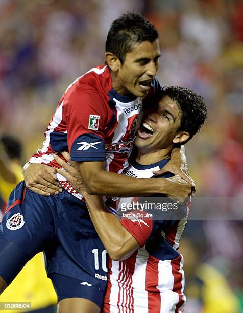Alberto Medina and Jonny Magallon of Chivas de Guadalajara celebrate after a goal during the Mexican First Division 'Clásico Nacional' match against...