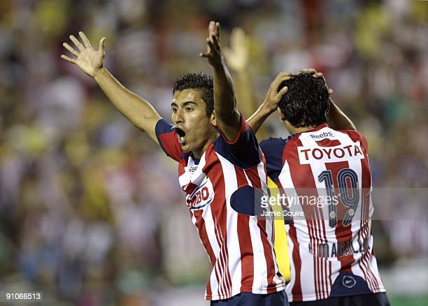 Alberto Medina and Jonny Magallon of Chivas de Guadalajara react after a goal was called back during the Mexican First Division 'Clásico Nacional'...
