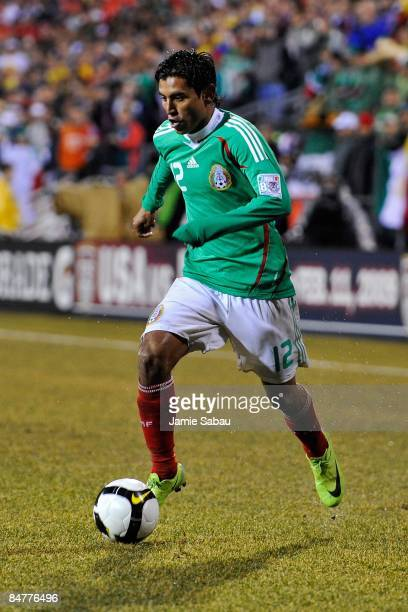 Alberto Medina of Mexico dribbles the ball against USA during a FIFA 2010 World Cup qualifying match in the CONCACAF region on February 11 2009 at...