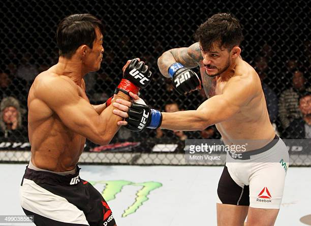 Alberto Mina of Brazil throws a punch at Yoshihiro Akiyama of Japan in their welterweight bout during the UFC Fight Night at the Olympic Park...