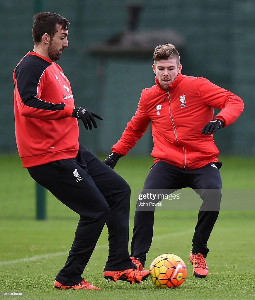 Alberto Moreno and Jose Enrique of Liverpool during a training session at Melwood Training Ground on December 24, 2015 in Liverpool, England.