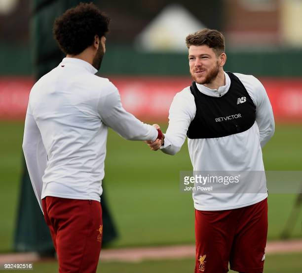 Alberto Moreno and Mohamed Salah of Liverpool during the training session at Melwood Training Ground on March 15 2018 in Liverpool England