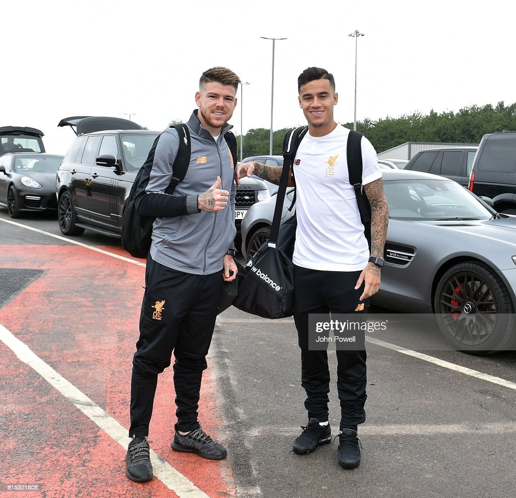Alberto Moreno and Philippe Coutinho of Liverpool arrives at Manchester Airport on July 16, 2017 in Liverpool, England.