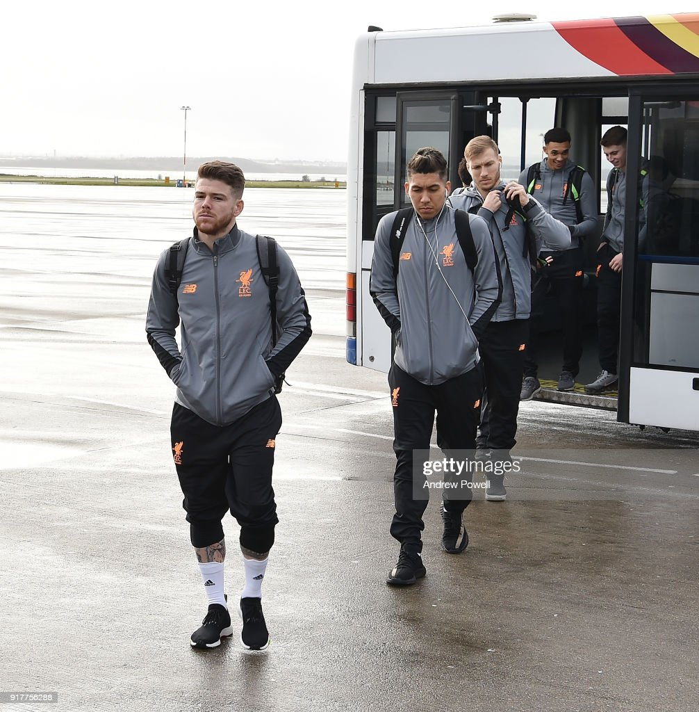 Alberto Moreno and Roberto Fimrino of Liverpool board the plane for their trip to Porto at Liverpool John Lennon Airport on February 13, 2018 in Liverpool, England.