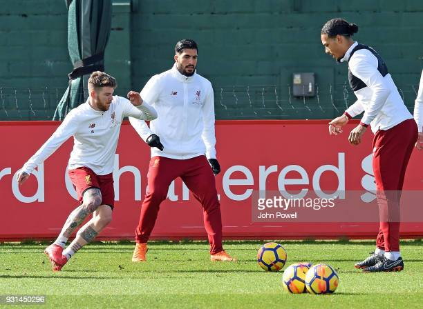 Alberto Moreno Emre Can and Virgil van Dijk of Liverpool during a training session at Melwood Training Ground on March 13 2018 in Liverpool England