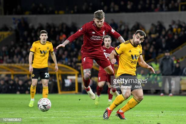 Alberto Moreno of Liverpool and Jonny Castro Otto of Wolverhampton Wanderers during the Emirates FA Cup Third Round match between Wolverhampton...