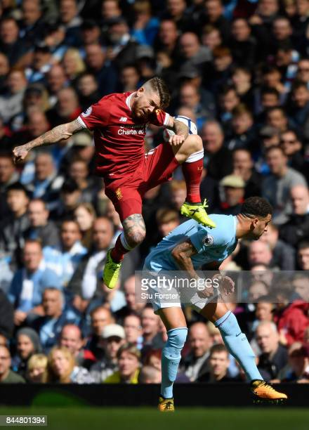 Alberto Moreno of Liverpool and Kyle Walker of Manchester City battle for possession during the Premier League match between Manchester City and...