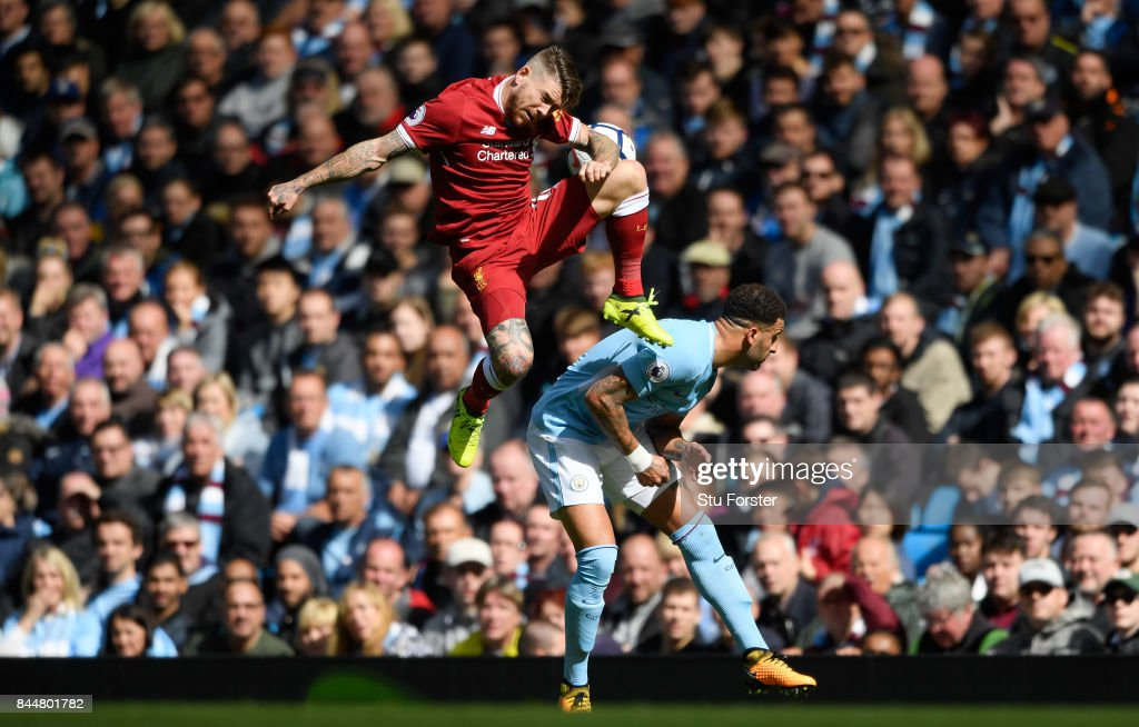 Alberto Moreno of Liverpool and Kyle Walker of Manchester City battle for possession during the Premier League match between Manchester City and Liverpool at Etihad Stadium on September 9, 2017 in Manchester, England.