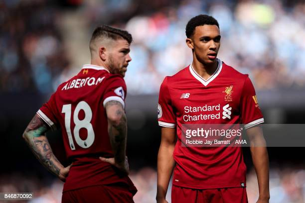 Alberto Moreno of Liverpool and Trent AlexanderArnold of Liverpool during the Premier League match between Manchester City and Liverpool at Etihad...