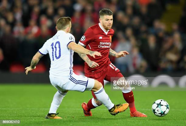 Alberto Moreno of Liverpool attempts to get past Dino Hotic of NK Maribor during the UEFA Champions League group E match between Liverpool FC and NK...