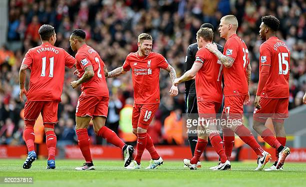 Alberto Moreno of Liverpool celebrates after scoring the opening goal during the Barclays Premier League match between Liverpool and Stoke City at...