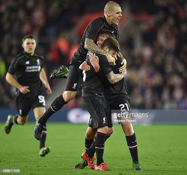 Alberto Moreno of Liverpool celebrates after scroing the third goal during the Capital One Cup Quarter Final match between Southampton and Liverpool...