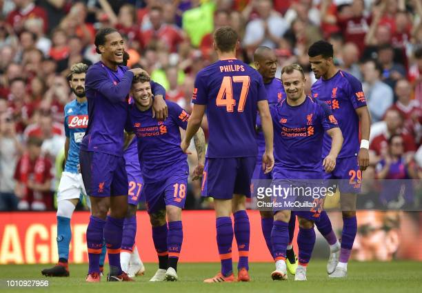Alberto Moreno of Liverpool celebrates with team mates after scoring during the international friendly game between Liverpool and Napoli at Aviva...