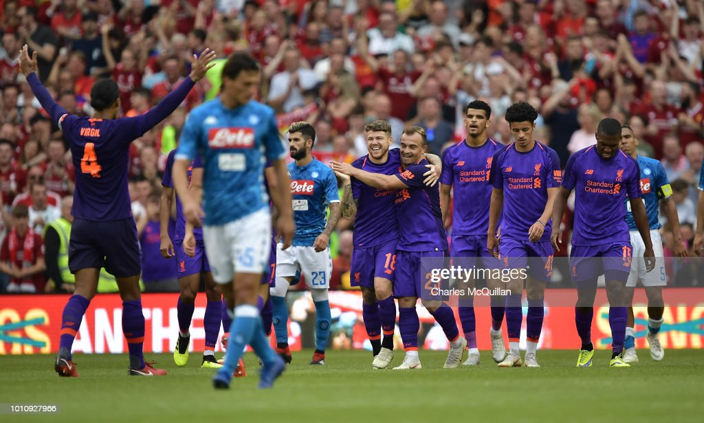 Alberto Moreno of Liverpool celebrates with team mates after scoring during the international friendly game between Liverpool and Napoli at Aviva Stadium on August 4, 2018 in Dublin, Ireland.