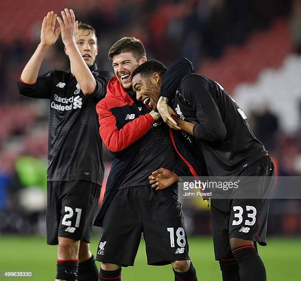 Alberto Moreno of Liverpool embraces Jordon Ibe at the end of the Capital One Cup Quarter Final match between Southampton and Liverpool at St Mary's...