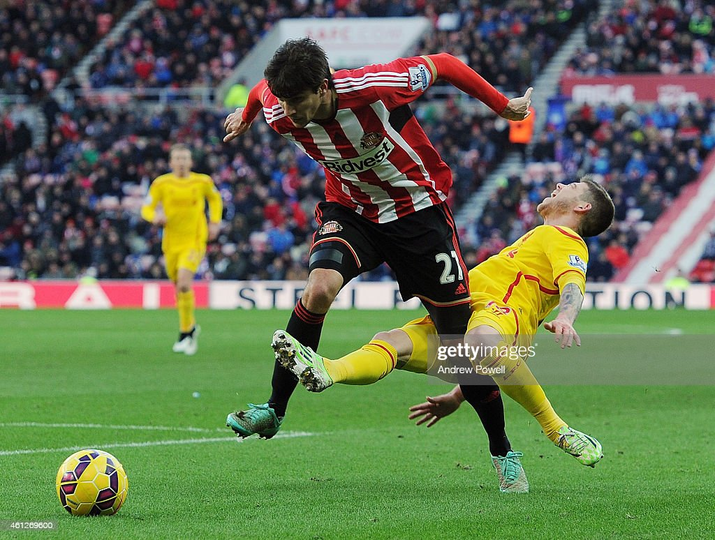 Alberto Moreno of Liverpool is brought down by Santiago Vergini of Sunderland during the Barclays Premier Leauge match between Sunderland and Liverpool at Stadium of Light on January 10, 2015 in Sunderland, England.