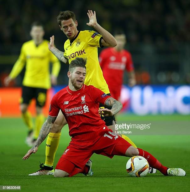 Alberto Moreno of Liverpool is challenged by Eric Durm of Borussia Dortmund during the UEFA Europa League quarter final first leg match between...