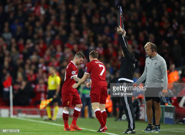 Alberto Moreno of Liverpool is subbed for James Milner of Liverpool during the UEFA Champions League group E match between Liverpool FC and Spartak...