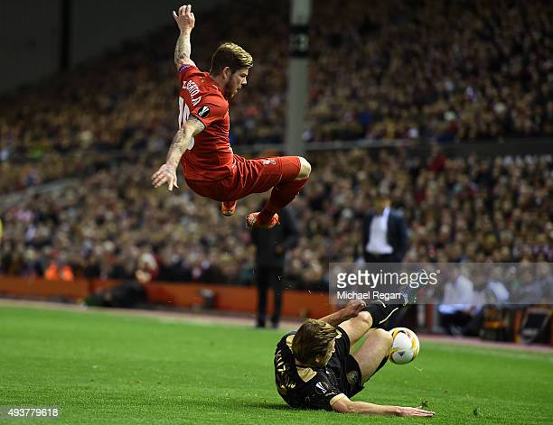 Alberto Moreno of Liverpool is tackled by Oleg Kuzmin of Rubin Kazan during the UEFA Europa League Group B match between Liverpool FC and Rubin Kazan...