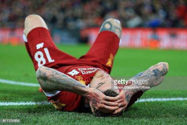 Alberto Moreno of Liverpool looks dejected during The Emirates FA Cup Fourth Round match between Liverpool and West Bromwich Albion at Anfield on...