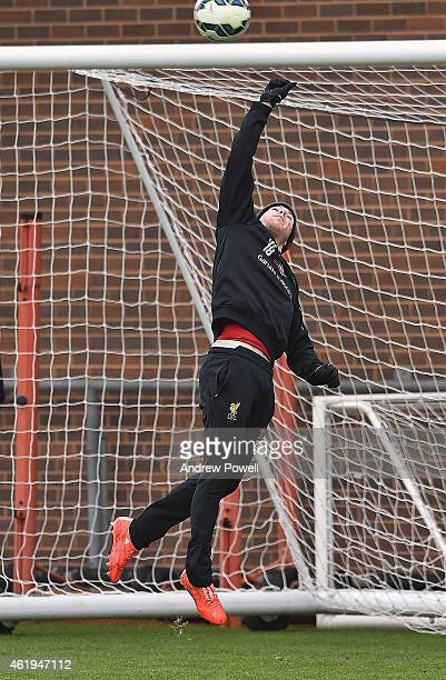 Alberto Moreno of Liverpool makes a save during a training session at Melwood Training ground on January 22 2015 in Liverpool England