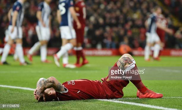 Alberto Moreno of Liverpool reacts during The Emirates FA Cup Fourth Round match between Liverpool and West Bromwich Albion at Anfield on January 27...