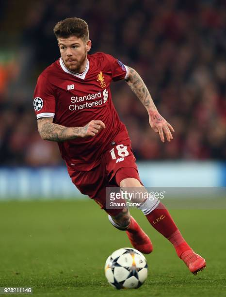 Alberto Moreno of Liverpool runs with the ball during the UEFA Champions League Round of 16 second leg match between Liverpool and FC Porto at...