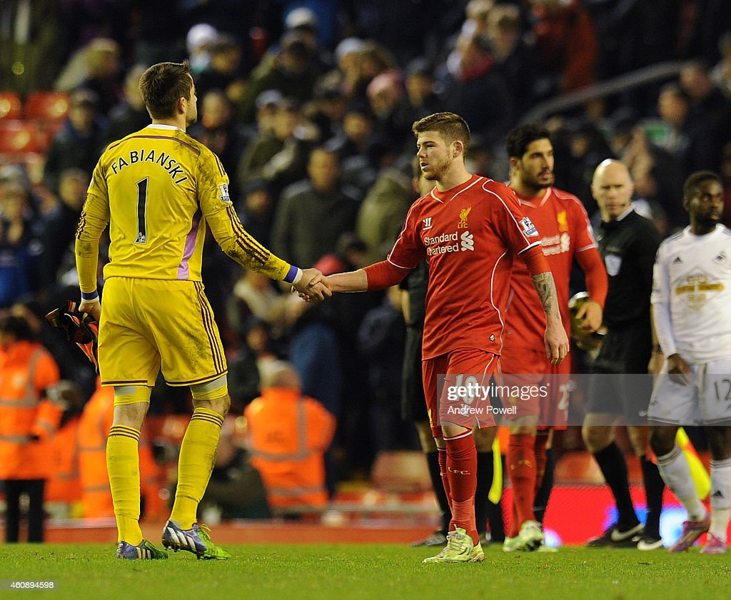 Alberto Moreno of Liverpool shakes hands with Lukasz Fabianski of Swansea City at the end of the Barclays Premier League match between Liverpool and Swansea City at Anfield on December 29, 2014 in Liverpool, England.