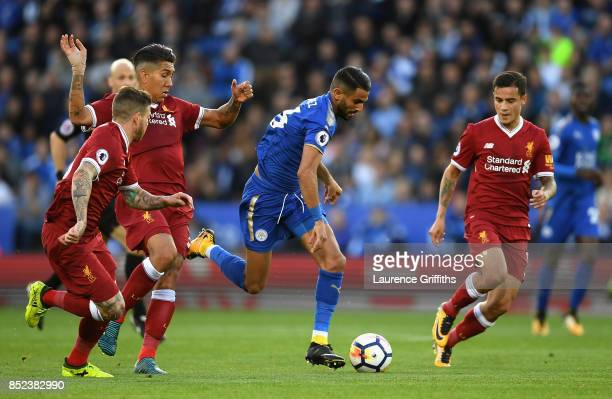 Alberto Moreno of Liverpool tackles Riyad Mahrez of Leicester City during the Premier League match between Leicester City and Liverpool at The King...