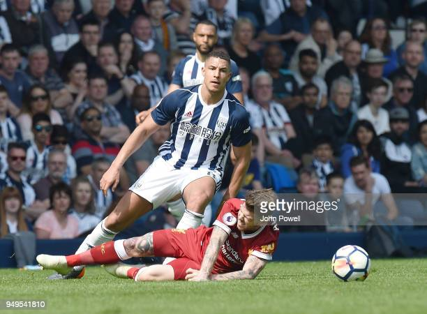 Alberto Moreno of Liverpool with Jake Livermore of West Bromwich during the Premier League match between West Bromwich Albion and Liverpool at The...