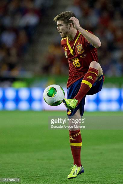 Alberto Moreno of Spain controls the ball during the FIFA 2014 World Cup Qualifier match between Spain and Georgia at Carlos Belmonte stadium on...