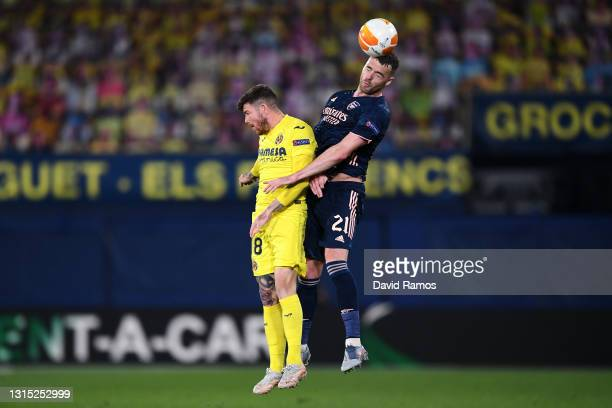 Alberto Moreno of Villarreal and Calum Chambers of Arsenal battle for a header during the UEFA Europa League Semi-final First Leg match between...