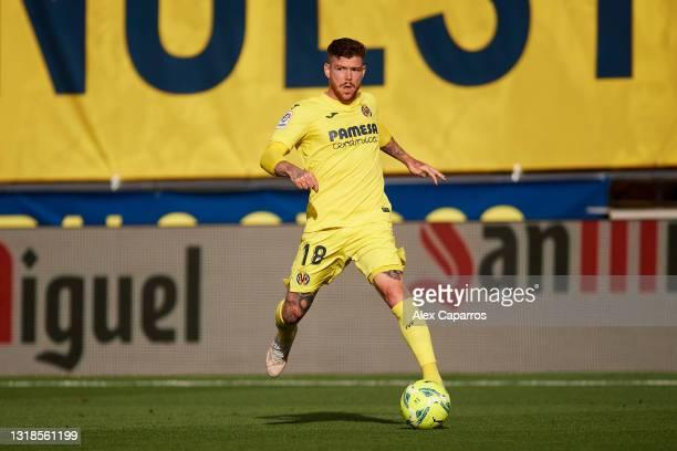 Alberto Moreno of Villarreal CF runs with the ball during the La Liga Santander match between Villarreal CF and Sevilla FC at Estadio de la Ceramica...