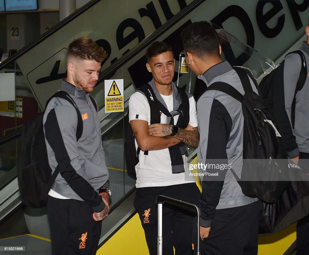Alberto Moreno, Philippe Coutinho and Roberto Firmino of Liverpool prepare for pre season tour at Manchester Airport on July 16, 2017 in Liverpool, England.