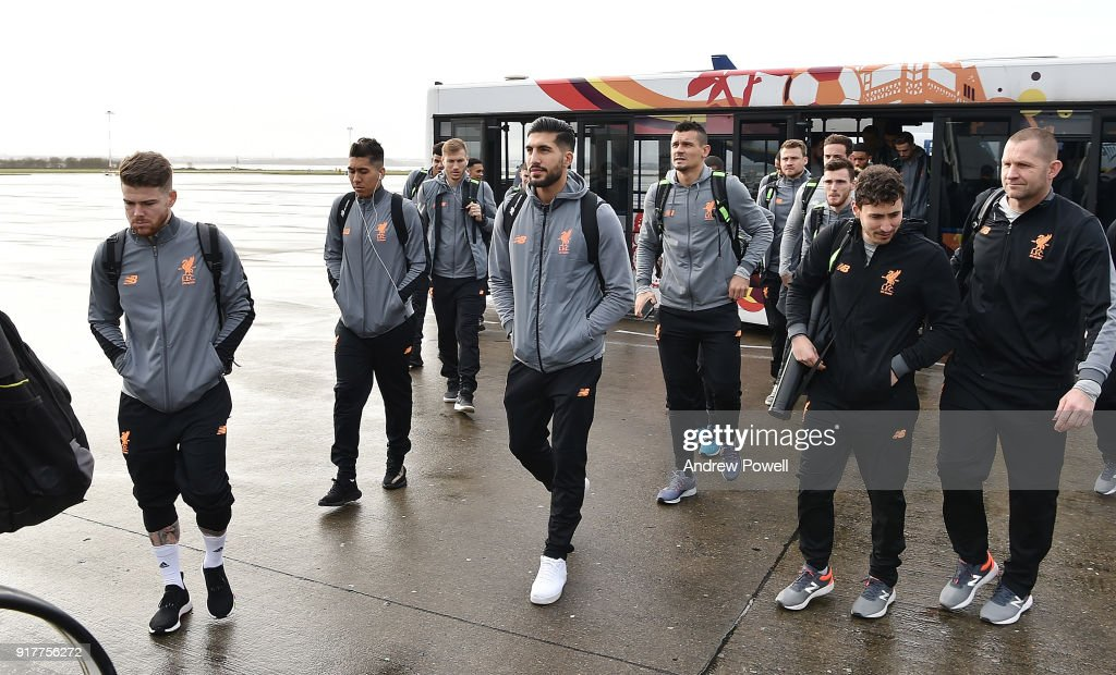 Alberto Moreno, Roberto Fimrino, Emre Can, Dejan Lovren and Ragnar Klavan of Liverpool board the plane for their trip to Porto at Liverpool John Lennon Airport on February 13, 2018 in Liverpool, England.