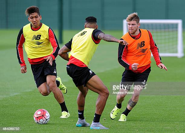 Alberto Moreno Roberto Firmino and Joe Gomez of Liverpool in action during a training session at Melwood Training Ground on August 15 2015 in...