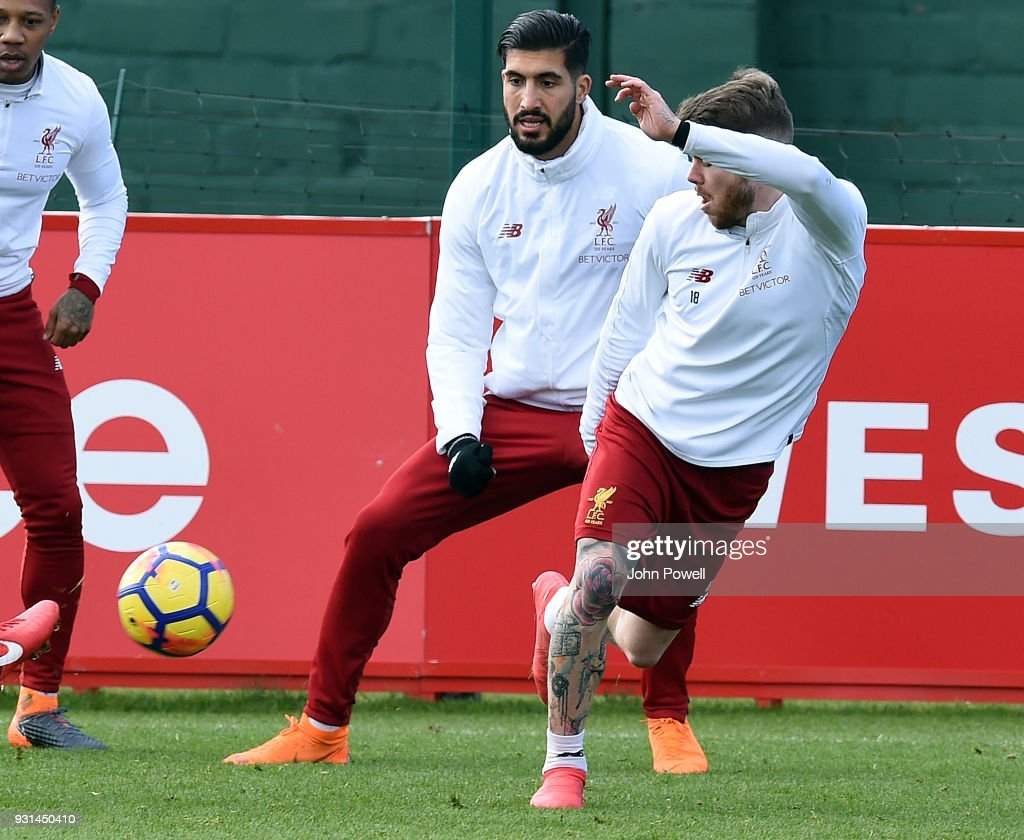 Alberto Moreno with Emre Can of Liverpool during a training session at Melwood Training Ground on March 13, 2018 in Liverpool, England.
