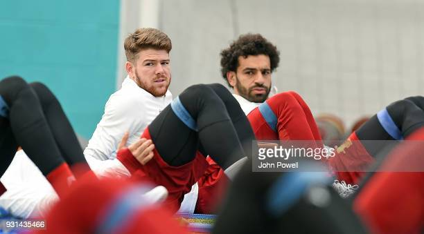 MARCH 13 Alberto Moreno with Mohamed Salah of Liverpool during a training session at Melwood Training Ground on March 13 2018 in Liverpool England