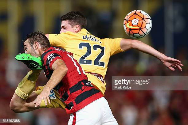 Alberto of the Wanderers is kicked in the throats as he compete for the ball with Jake McGing of the Mariners during the round 26 ALeague match...