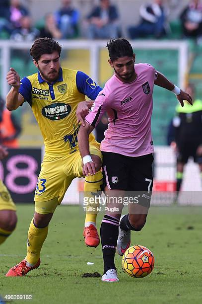 Alberto Paloschi of Chievo Verona and Achraf Lazaar of Palermo compete for the ball during the Serie A match between US Citta di Palermo and AC...