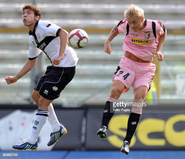 Alberto Paloschi of Parma jumps for a header with Simon Kjaer of Palermo during Serie A match played between Parma FC and US Citta di Palermo at...