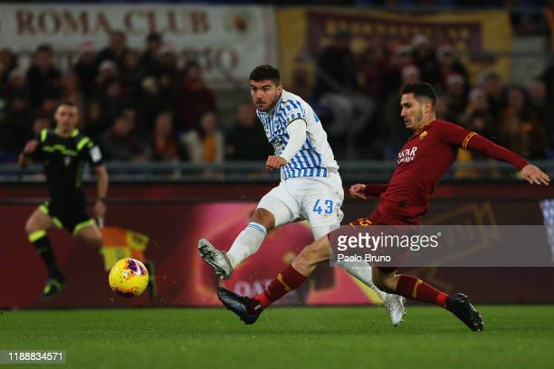 Alberto Paloschi of SPAL competes for the ball with Mert Cetin of AS Roma during the Serie A match between AS Roma and SPAL at Stadio Olimpico on...