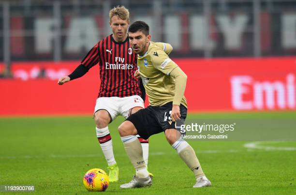 Alberto Paloschi of SPAL competes for the ball with Simon Kjaer of Milan during the Coppa Italia match between AC Milan and SPAL at Stadio Giuseppe...