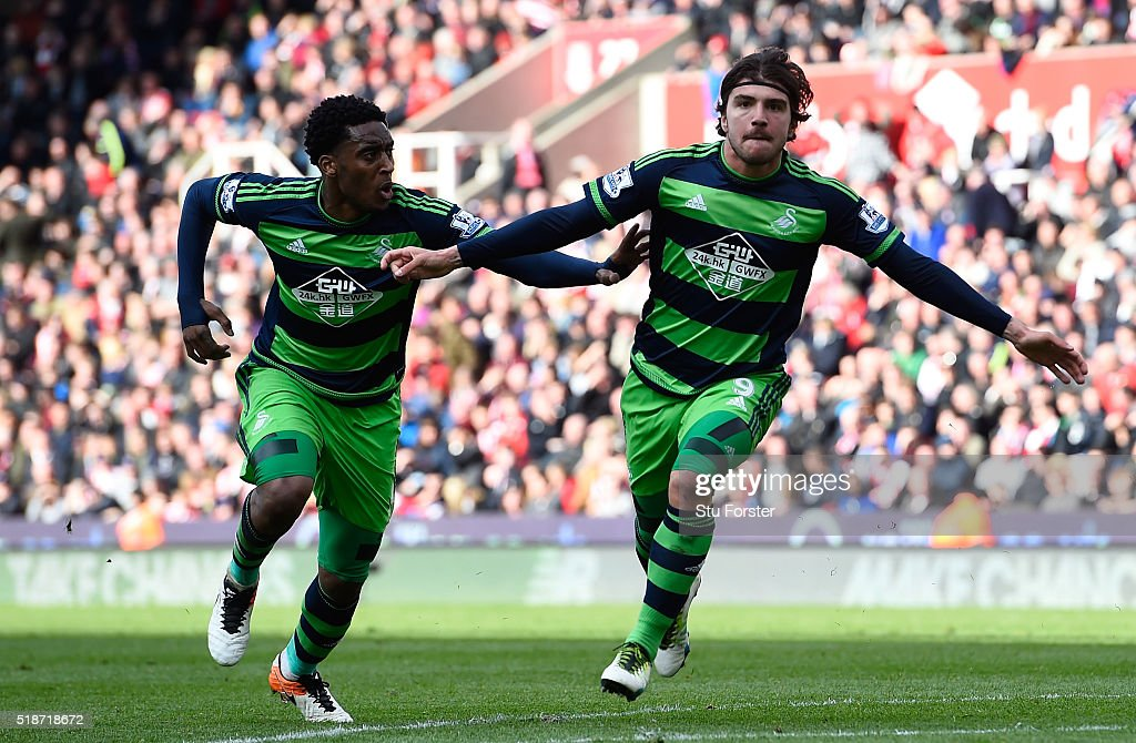 Alberto Paloschi (R) of Swansea City celebrates scoring his team's second goal with his team mate Leroy Fer (L) during the Barclays Premier League match between Stoke City and Swansea City at Britannia Stadium on April 2, 2016 in Stoke on Trent, England.