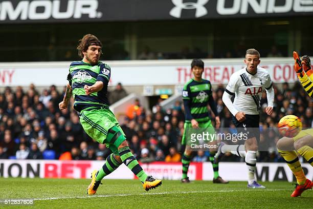 Alberto Paloschi of Swansea City scores the opening goal during the Barclays Premier League match between Tottenham Hotspur and Swansea City at White...