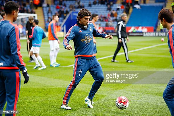 Alberto Paloschi of Swansea warms up at King Power Stadium ahead of the Barclays Premier League match between Leicester City and Swansea City at the...