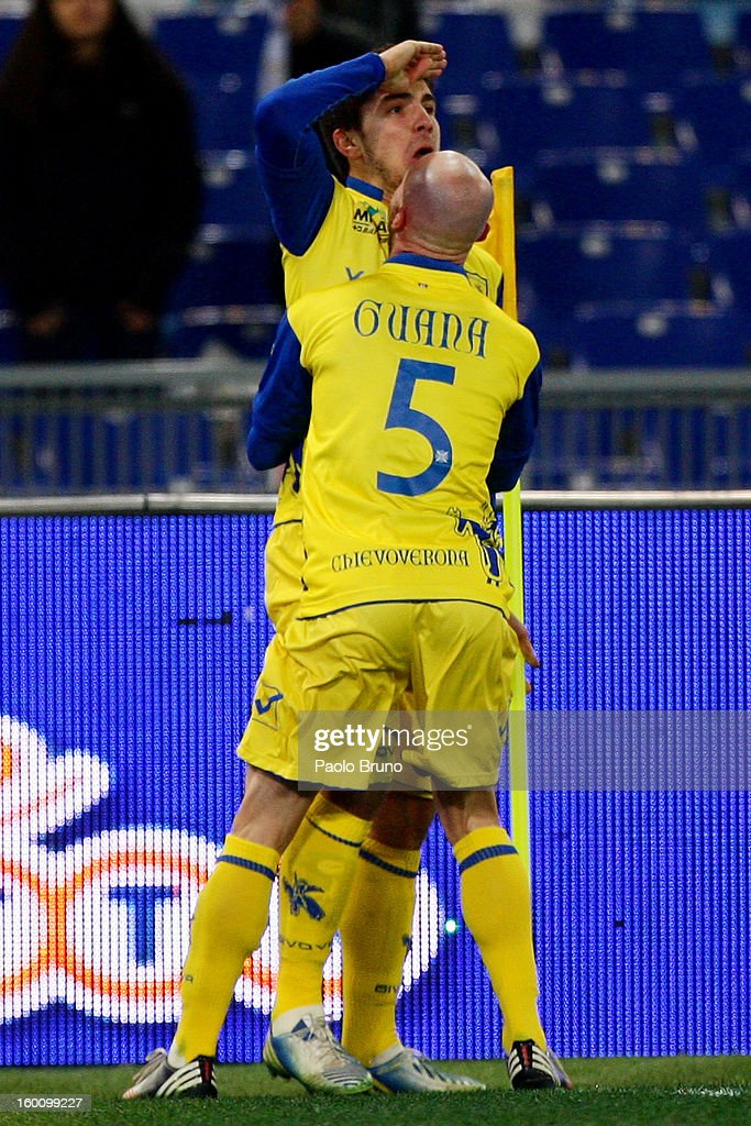 Alberto Paloschi (L) with his teammate Roberto Guana of AC Chievo Verona celebrates after scoring the opening goal during the Serie A match between S.S. Lazio and AC Chievo Verona at Stadio Olimpico on January 26, 2013 in Rome, Italy.