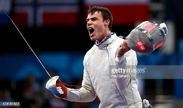 Alberto Pellegrini of Italy celebrates his victory over Fernando Casares of Spain compete during the Men's Fencing Individual Sabre quarter finals on...