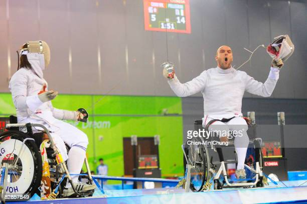 BEIJING SEPTEMBER 17 Alberto Pellegrini of Italy takes off his mask as he wins the bronze medal after competing against Wing Kin Chan of Hong Kongin...